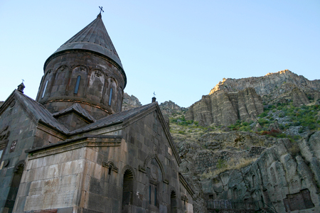 geghard: Armenian ancient Geghard Monastery and the mountains behind of it Stock Photo