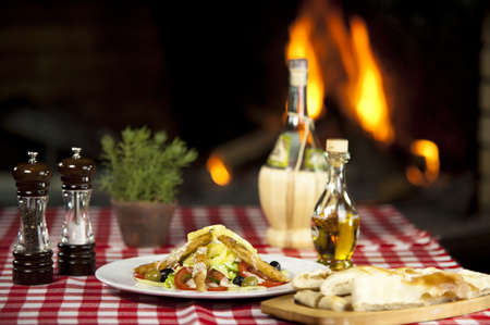 sallad: Chicken Sallad With Fried Chicken in Front of the Fireplace