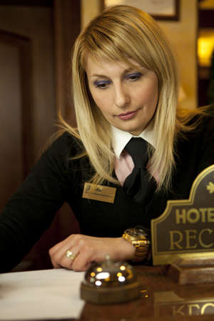 Young Woman Hotel Receptionist At The Front Desk photo