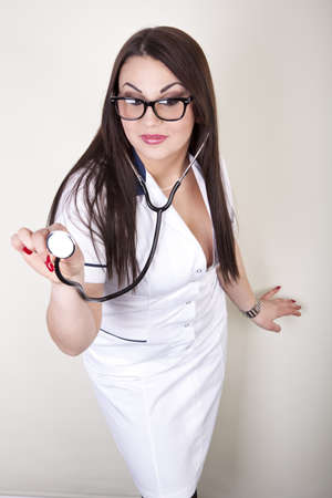 Beautiful young female doctor with stethoscope. photo