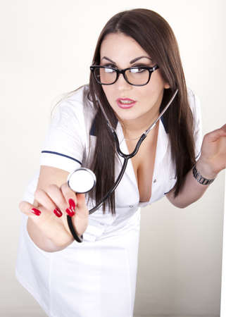 sexy female doctor: Beautiful young female doctor with stethoscope. Stock Photo