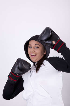 Young attractive woman with boxing gloves Stock Photo - 13757252