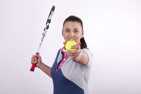 Woman holding tennis racquet and ball Stock Photo - 13757138