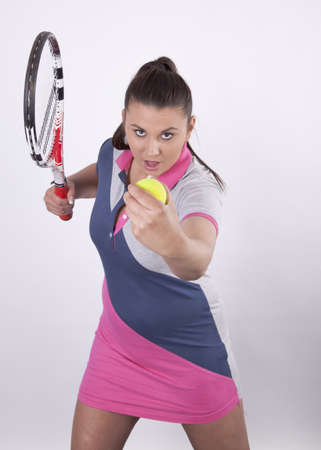 Woman holding tennis racquet and ball photo