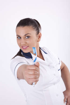 Young female dentist with toothbrush Stock Photo - 13757137