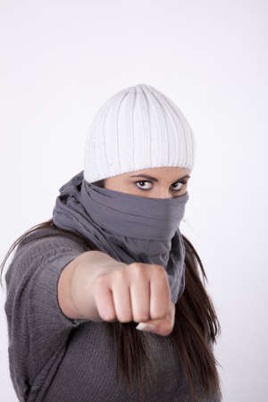 demonstrator: Young masked woman demonstrator holding fist. Stock Photo