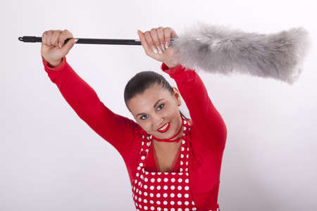 Young attractive housewife dusting. photo