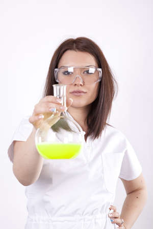 Beautiful young female laboratory technician with test tube in her hand Stock Photo - 13757238