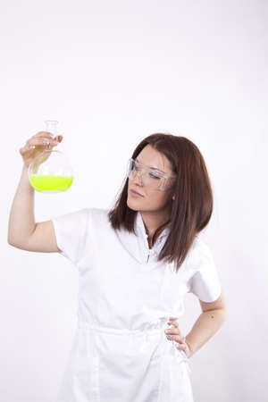 Beautiful young female laboratory technician with test tube in her hand Stock Photo - 13757179