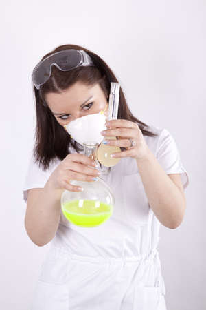 Beautiful young female laboratory technician with test tubes in her hands photo