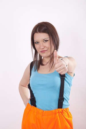 Young woman worker showing thumb up. photo