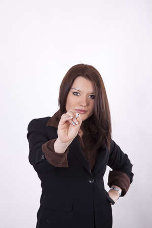 Young business woman pointing forward with a pen. photo
