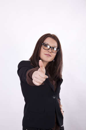 Young beautiful business woman showing thumb up. photo