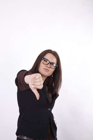 Young beautiful business woman showing thumb down. photo