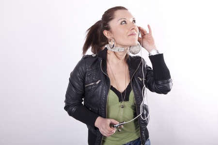 Young beautiful woman looking up while listening to her music. photo