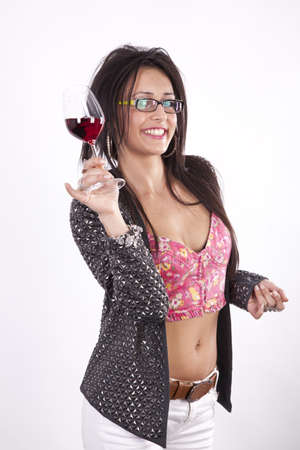 Young beautiful woman holding a glass of red wine and smiling. Stock Photo - 13757309