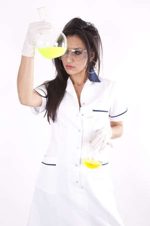Young attractive lab technician with yellow liquid in a test tube. photo