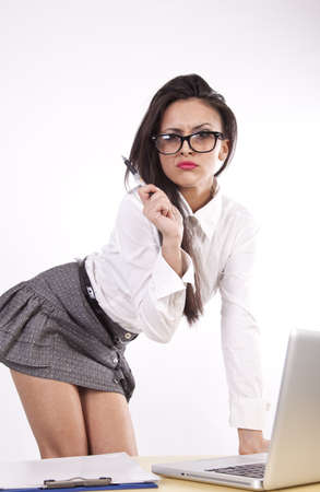 Young attractive sexy business woman with glasses stressed. photo