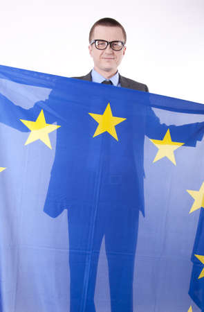 fanatics: Man holding flag of European Union and smiling.