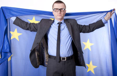 fanaticism: Man holding flag of European Union with both hands.