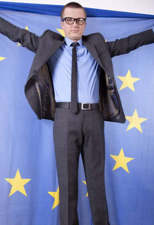 fanaticism: Man holding flag of European Union with both hands