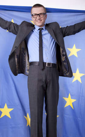 Man holding flag of European Union and smiling. photo