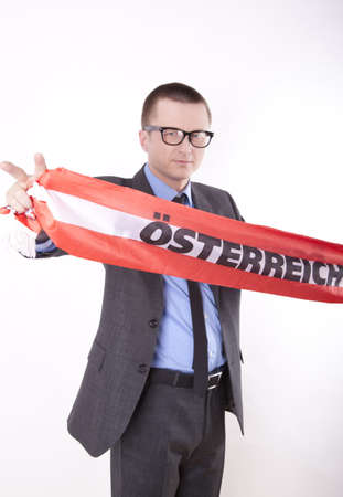 Man holding flag of Austria and showing victory sign. photo