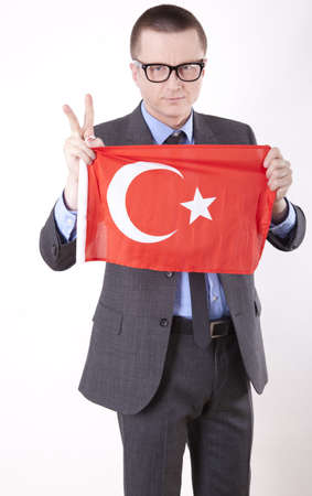 fanaticism: Man holding flag of Turkey and showing victory sign. Stock Photo