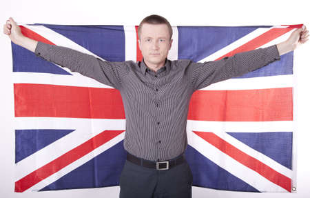 Man holding flag of Great Britain with both hands  photo