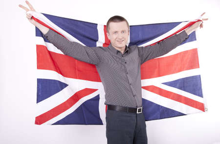 fanaticism: Man holding flag of Great Britain with both hands and showing victory sign. Stock Photo
