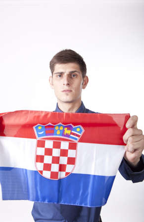 Man holding flag of Croatia. photo