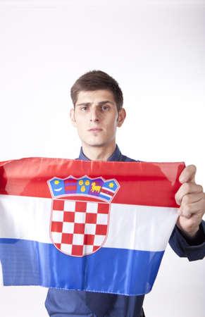 Man holding flag of Croatia. photo