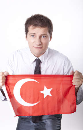Man holding flag of Turkey. photo