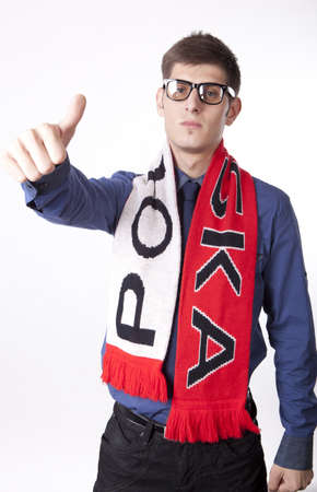 Man wearing Poland scarf and showing thumb up. photo