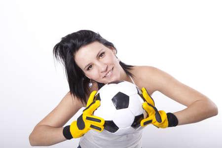 sexy young girls: Девушка держит в футбол и улыбается.