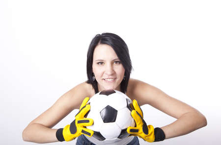 Girl holding a football and smiling. Stock Photo - 13757111