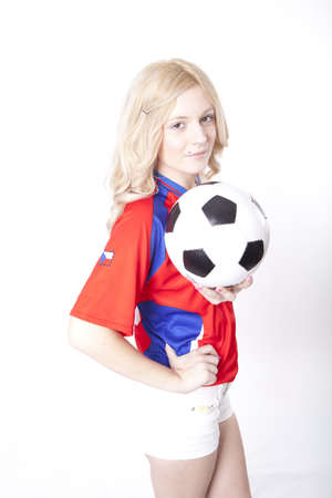 Girl wearing Czech republic football shirt holding ball. photo