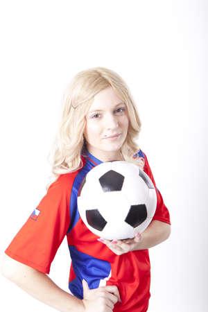Girl wearing Czech republic football shirt holding ball. Stock Photo - 13757181