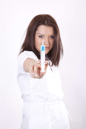 Young beautiful female doctor holding syringe  photo