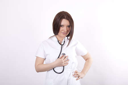 Young beautiful female doctor holding stethoscope Stock Photo - 13827476