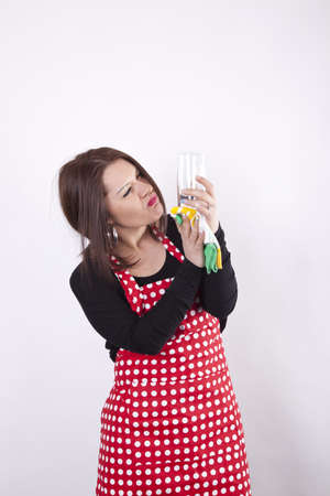 Young beautiful stressed housewife polishing glass Stock Photo - 13819417