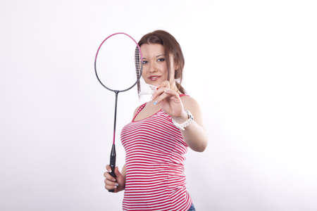 Young woman badminton player ready to serve. photo