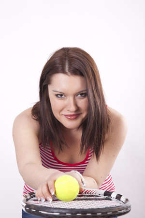 Young attractive woman holding her tennis racquet photo