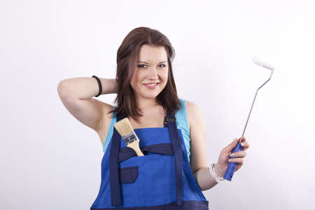 Young beautiful woman painter with tools. Stock Photo - 13827893