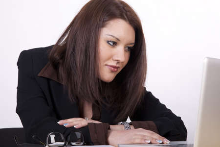 Young beautiful business woman working at the office. photo