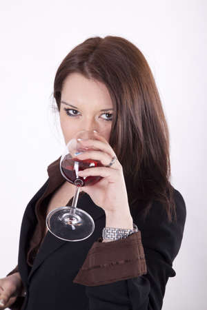 Young beautiful woman drinking glass of red wine photo