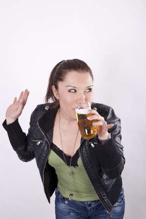 Young beautiful woman with a glass of beer. photo