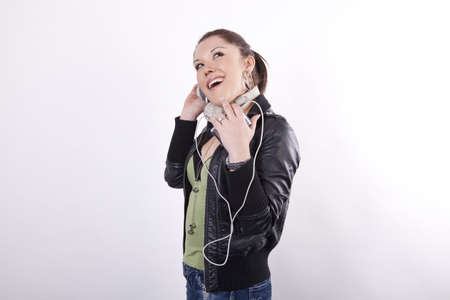 Young beautiful woman listening music and smiling. photo