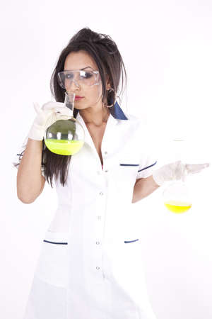 Young woman lab technician holding a test tube with yellow liquid. photo