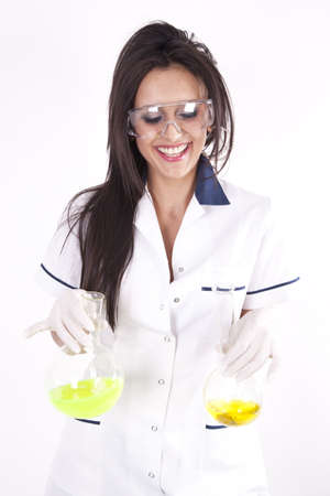 Young woman lab technician holding a test tube with yellow liquid and smiling. photo